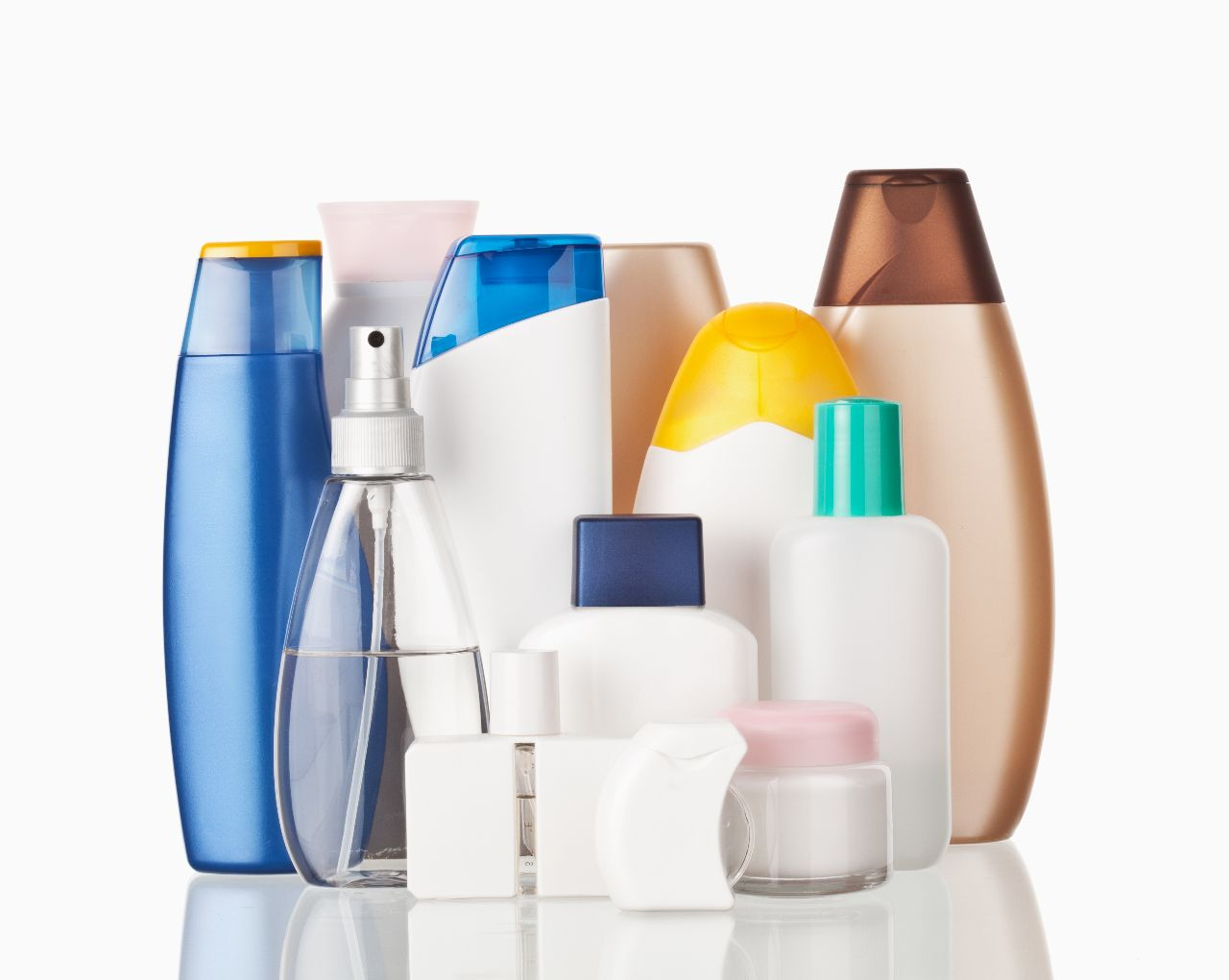 Many different coloured bottles with personal care products. without any tradenames.
