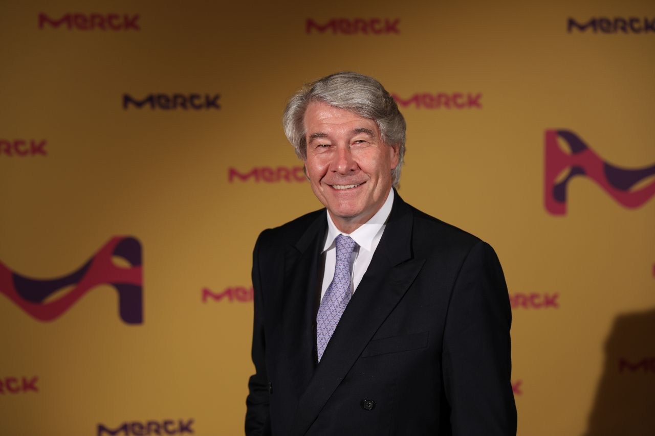 Wolfgan Büchele, the re-elected Chairman of the supervisory board of Merck in front of a Merck press wall