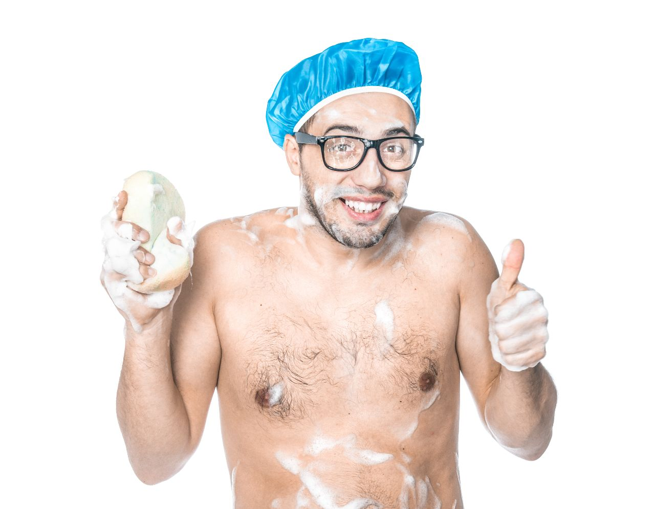 Man with blue cap taking a shower, left thumb up and holding a sponge in his right hand.
