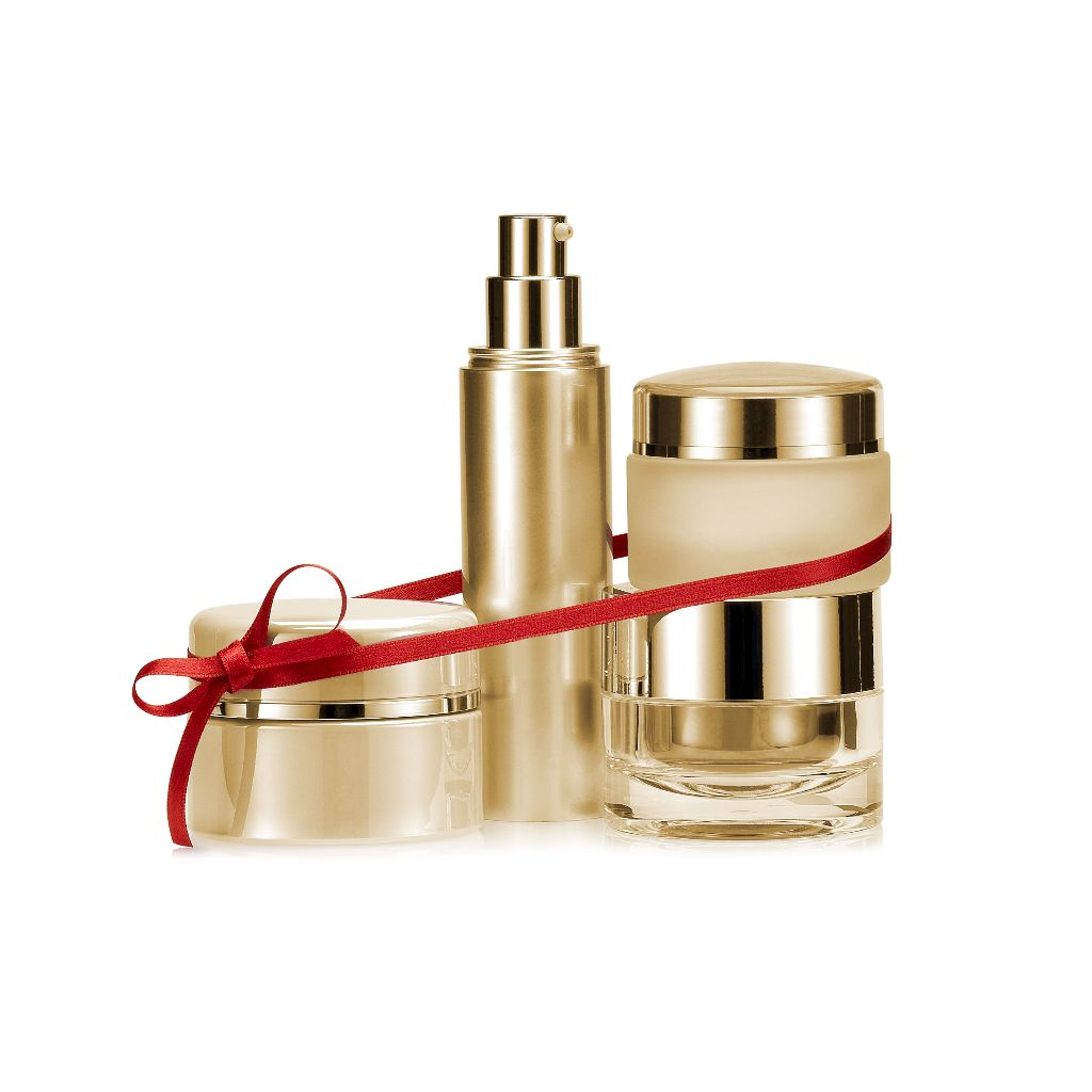 some golden pots typically containig personal care products