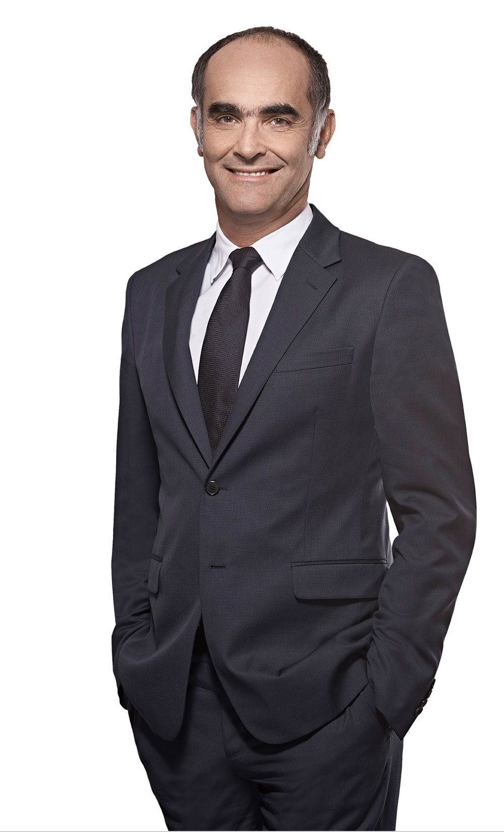 Portrait of Gilles Andrier, CEO of Givaudan standing with hand hin pocket of the trouser