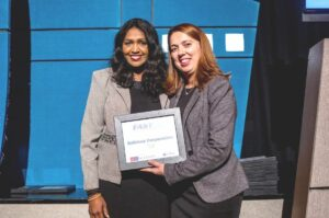 The award was accepted by Ms. Asha Ramesh (left), Sabinsa USA's CEO at an awards ceremony