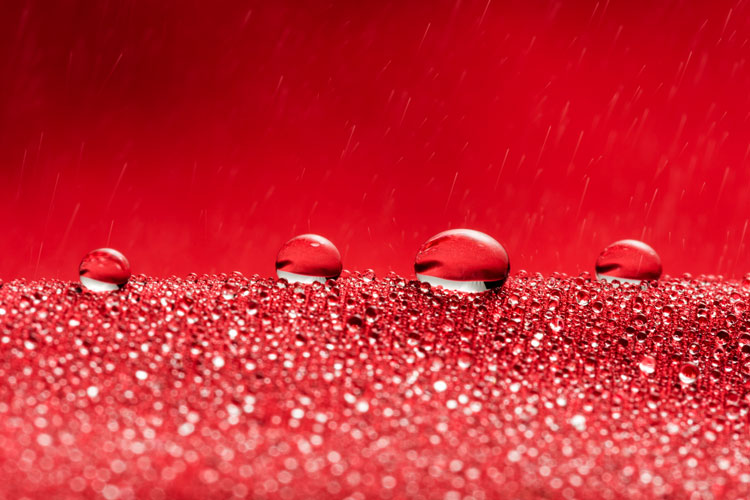 water droplets on red fabric
